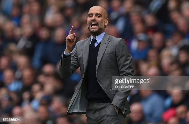 Manchester City's Spanish manager Pep Guardiola shouts instructions to his players from the touchline during the English Premier League football...