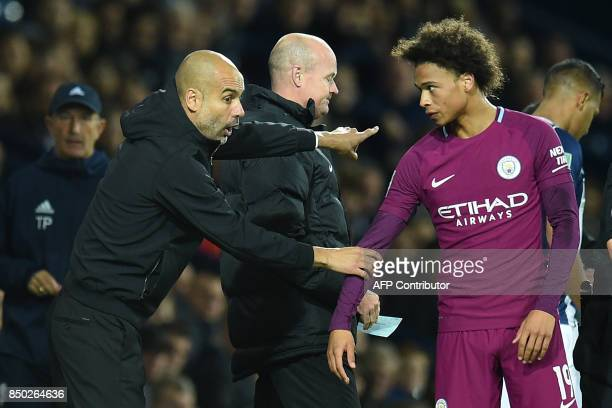 Manchester City's Spanish manager Pep Guardiola speaks with Manchester City's German midfielder Leroy Sane during the English League Cup third round...