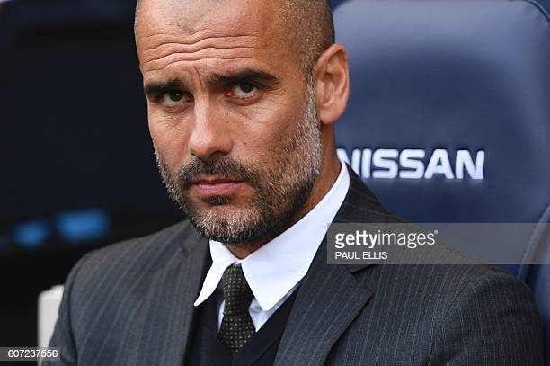 Manchester City's Spanish manager Pep Guardiola waits for kick off of the English Premier League football match between Manchester City and...