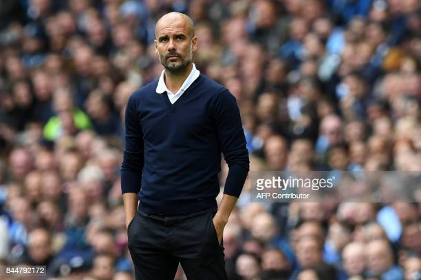 Manchester City's Spanish manager Pep Guardiola watches from the touchline during the English Premier League football match between Manchester City...
