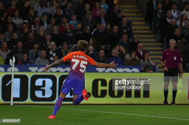 Manchester City's Spanish midfielder Aleix Garcia Serrano celebrates scoring his team's second goal during the English League Cup third round...