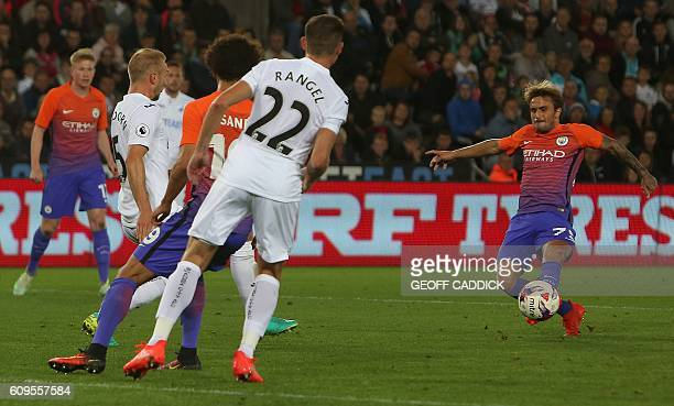 Manchester City's Spanish midfielder Aleix Garcia Serrano scores his team's second goal during the English League Cup third round football match...