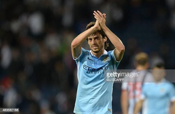 Manchester City's Spanish midfielder David Silva applauds fans after winning the English Premier League football match between West Bromwich Albion...