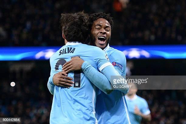 Manchester City's Spanish midfielder David Silva celebrates scoring the opening goal with Manchester City's English midfielder Raheem Sterling during...
