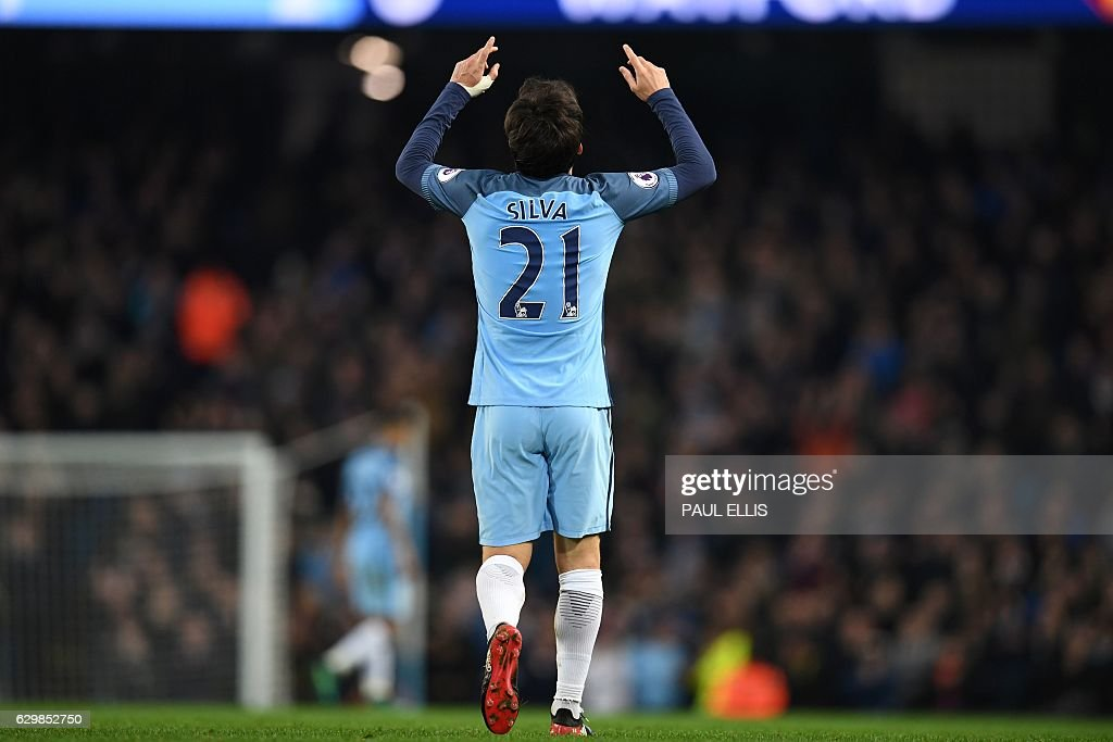 Manchester City's Spanish midfielder David Silva celebrates scoring their second goal during the English Premier League football match between Manchester City and Watford at the Etihad Stadium in Manchester, north west England, on December 14, 2016. / AFP / Paul ELLIS / RESTRICTED TO EDITORIAL USE. No use with unauthorized audio, video, data, fixture lists, club/league logos or 'live' services. Online in-match use limited to 75 images, no video emulation. No use in betting, games or single club/league/player publications. /