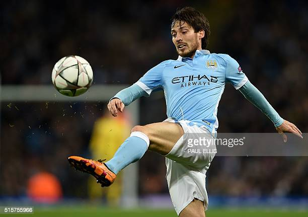 Manchester City's Spanish midfielder David Silva clears the ball during a UEFA Champions League last 16 second leg football match between Manchester...