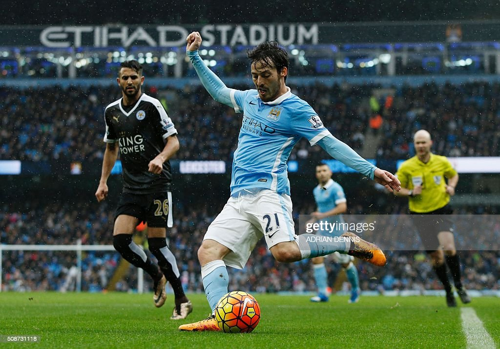 Manchester City's Spanish midfielder David Silva crosses the ball during the English Premier League football match between Manchester City and Leicester City at the Etihad Stadium in Manchester, north west England, on February 6, 2016. / AFP / ADRIAN DENNIS / RESTRICTED TO EDITORIAL USE. No use with unauthorized audio, video, data, fixture lists, club/league logos or 'live' services. Online in-match use limited to 75 images, no video emulation. No use in betting, games or single club/league/player publications. /