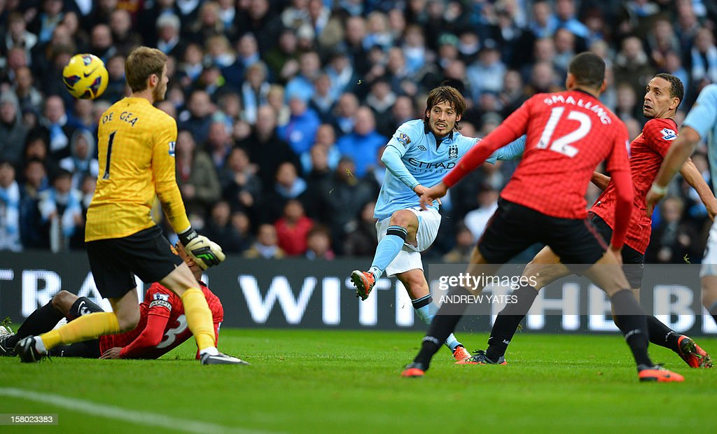 """Manchester City's Spanish midfielder David Silva (3rd R) shoots during the English Premier League football match between Manchester City and Manchester United at The Etihad stadium in Manchester, north-west England on December 9, 2012. AFP PHOTO/ANDREW YATES USE. No use with unauthorized audio, video, data, fixture lists, club/league logos or """"live"""" services. Online in-match use limited to 45 images, no video emulation. No use in betting, games or single club/league/player publications."""