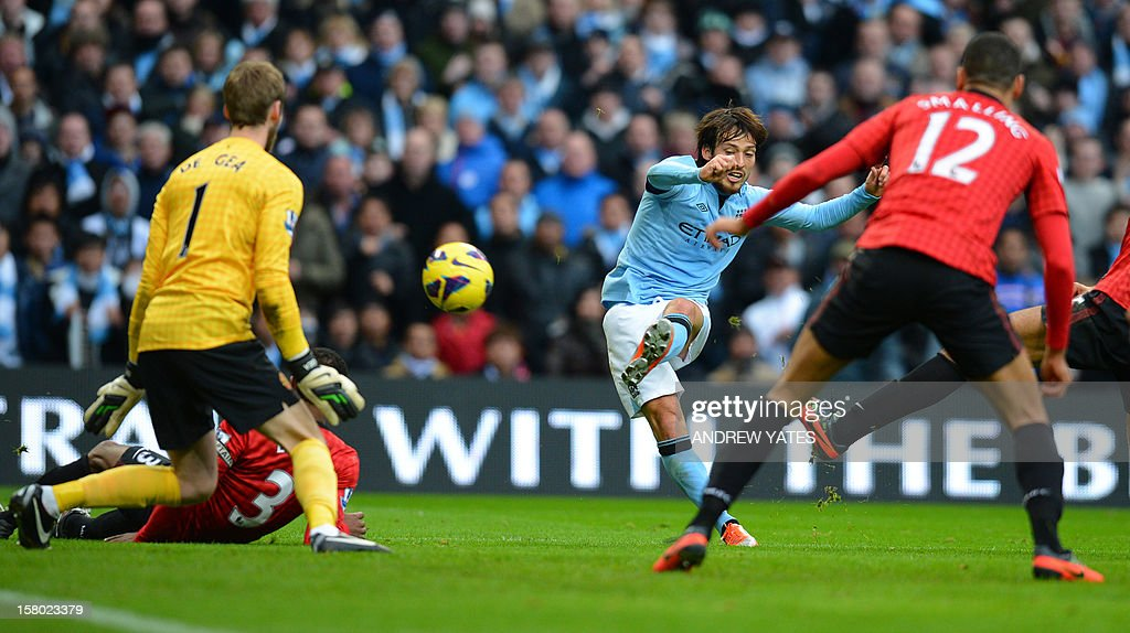 """Manchester City's Spanish midfielder David Silva (2nd R) shoots in the build-up to City's second goal during the English Premier League football match between Manchester City and Manchester United at The Etihad stadium in Manchester, north-west England on December 9, 2012. USE. No use with unauthorized audio, video, data, fixture lists, club/league logos or """"live"""" services. Online in-match use limited to 45 images, no video emulation. No use in betting, games or single club/league/player publications."""
