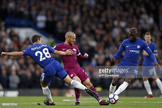 Manchester City's Spanish midfielder David Silva vies with Chelsea's Spanish defender Cesar Azpilicueta and Chelsea's French midfielder Tiemoue...