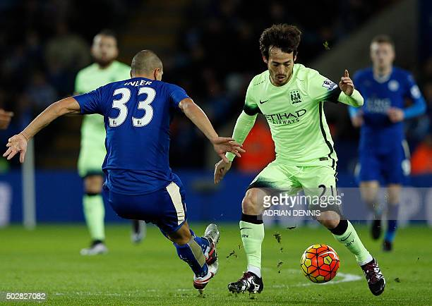 Manchester City's Spanish midfielder David Silva vies with Leicester Citys Swiss midfielder Gokhan Inler during the English Premier League football...