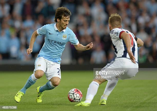 Manchester City's Spanish midfielder David Silva vies with West Bromwich Albion's Englishborn Scottish midfielder James Morrison during the English...