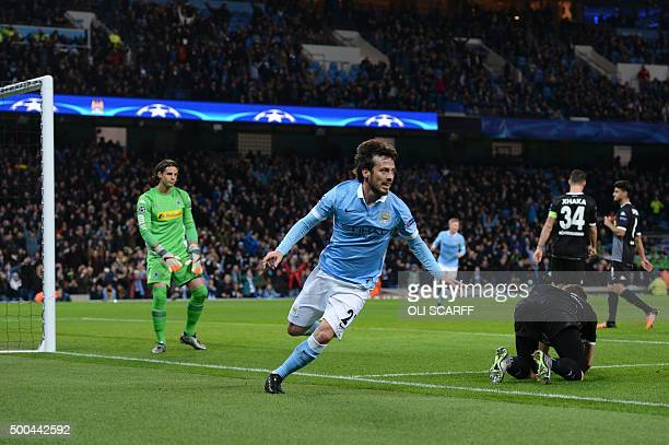 Manchester City's Spanish midfielder David Silva wheels away to celebrate scoring the opening goal during the UEFA Champions League Group D football...