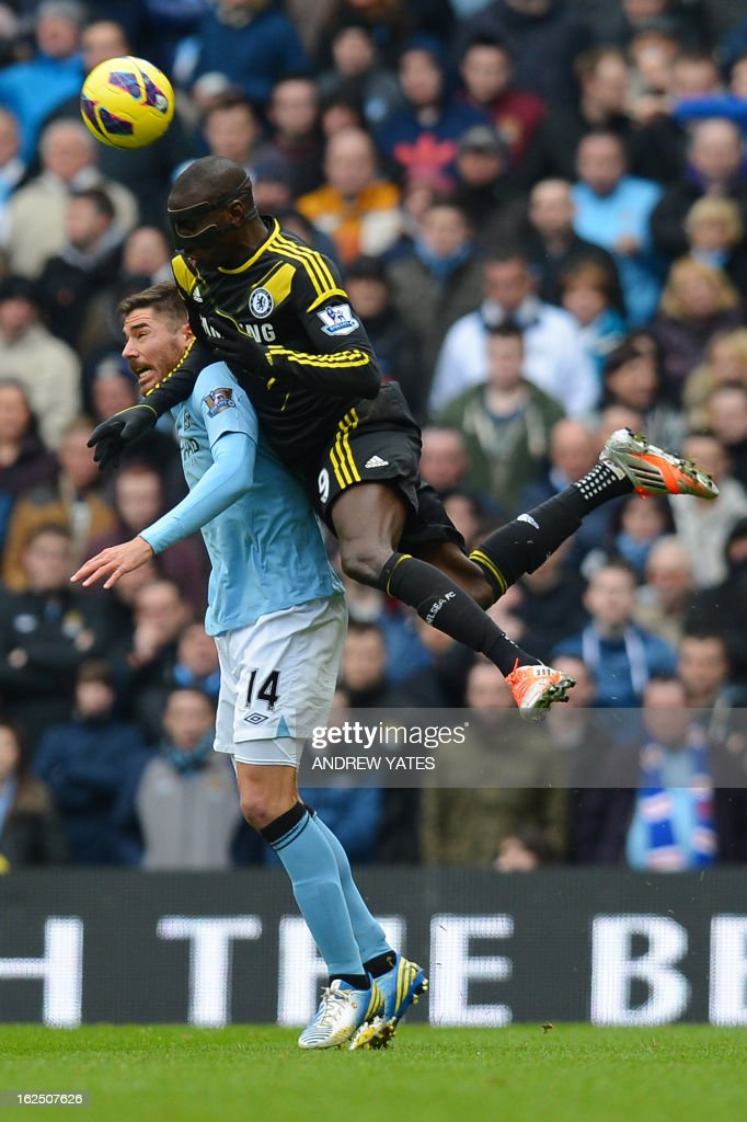 """Manchester City's Spanish midfielder Javi Garcia (L) vies with Chelsea's French-born Senegalese striker Demba Ba (R) during the English Premier League football match between Manchester City and Chelsea at the Etihad Stadium in Manchester, northwest England, on February 24, 2013. USE. No use with unauthorized audio, video, data, fixture lists, club/league logos or """"live"""" services. Online in-match use limited to 45 images, no video emulation. No use in betting, games or single club/league/player publications."""