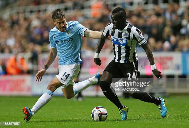 Manchester City's Spanish midfielder Javi Garcia vies with Newcastle United's Ivorian midfielder Cheick Tiote during the English League Cup fourth...