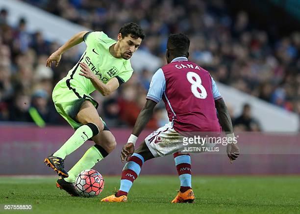 Manchester City's Spanish midfielder Jesus Navas in action against Aston Villa's Senegalese midfielder Idrissa Gana during the English FA Cup fourth...