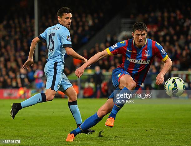 Manchester City's Spanish midfielder Jesus Navas vies with Crystal Palace's English defender Martin Kelly during the English Premier League football...