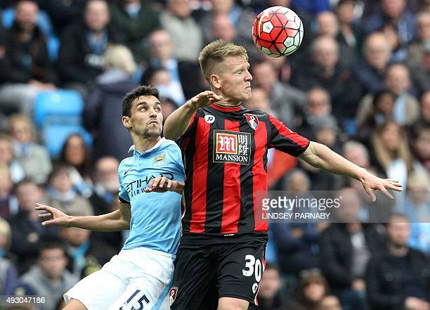 Manchester City's Spanish midfielder Jesus Navas vies with Bournemouth's English midfielder Matt Ritchie during the English Premier League football...