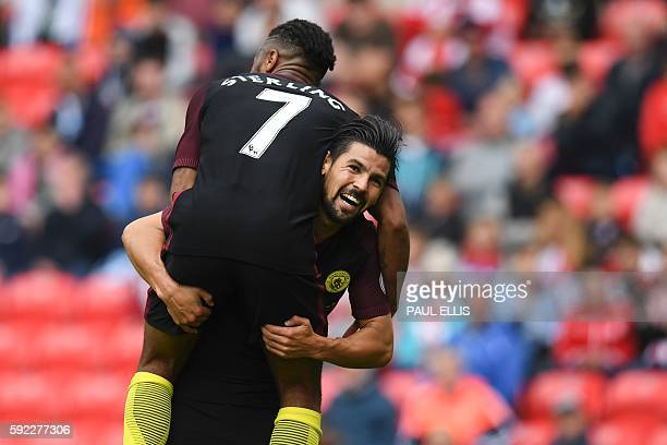 Manchester City's Spanish midfielder Nolito celebrates with Manchester City's English midfielder Raheem Sterling after scoring their fourth goal...