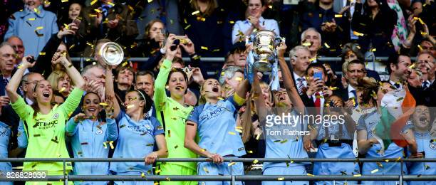 Manchester City's Steph Houghton and Jill Scott celebrates winning the FA Cup with their teammates