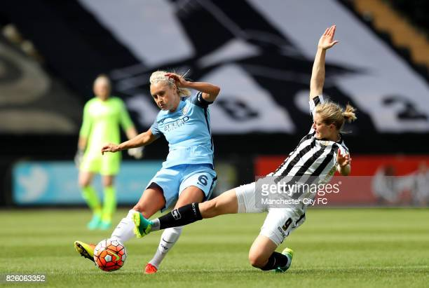 Manchester City's Steph Houghton and Notts County's Ellen White battle for the ball