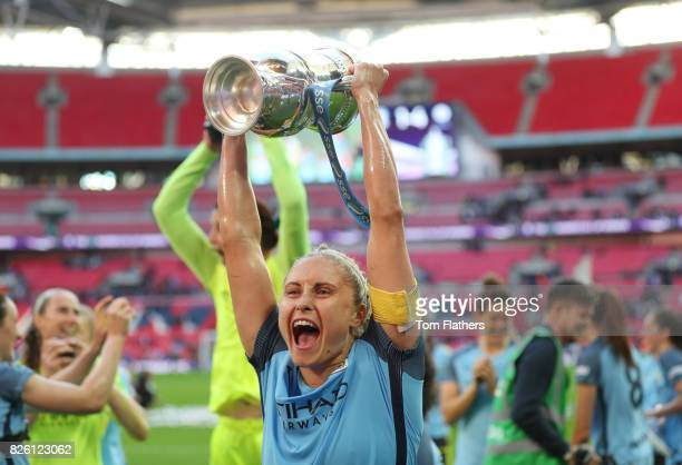 Manchester City's Steph Houghton celebrates with the SSE Women's FA Cup trophy