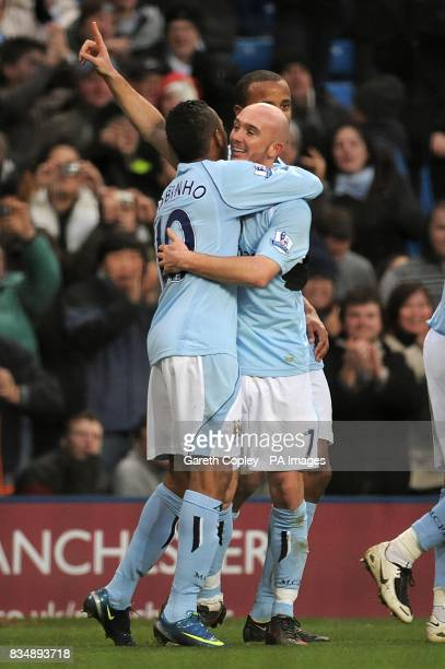 Manchester City's Stephen Ireland celebrates with team mate De Souza Robinho after scoring the first goal of the game