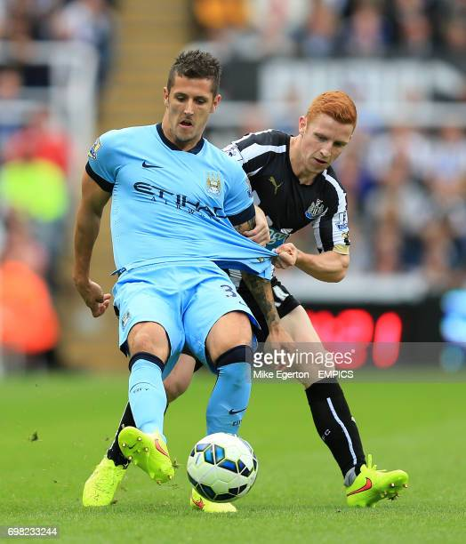 Manchester City's Stevan Jovetic and Newcastle United's Jack Colback battle for the ball