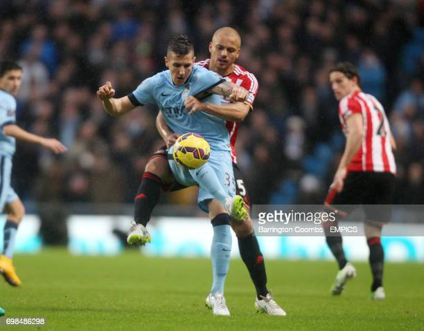 Manchester City's Stevan Jovetic and Sunderland's Wes Brown