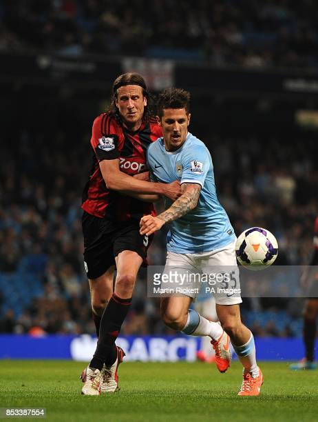 Manchester City's Stevan Jovetic and West Bromwich Albion's Jonas Olsson battle for the ball