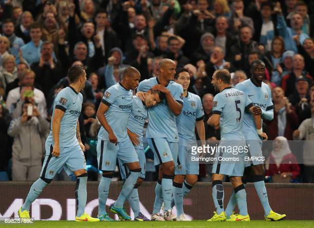 Manchester City's Stevan Jovetic celebrates scoring against Liverpool with his team mates