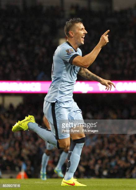 Manchester City's Stevan Jovetic celebrates scoring his teams opening goal during the Barclays Premier League match at the Etihad Stadium Manchester
