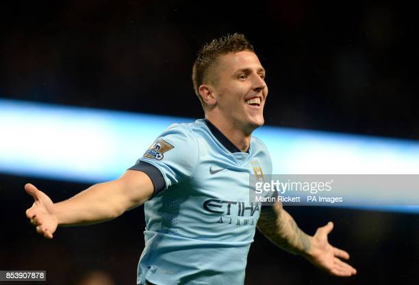 Manchester City's Stevan Jovetic celebrates scoring his teams second goal during the Barclays Premier League match at the Etihad Stadium Manchester