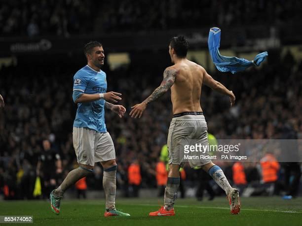 Manchester City's Stevan Jovetic celebrates scoring his teams third goal of the game with teammate Aleksandar Kolarov