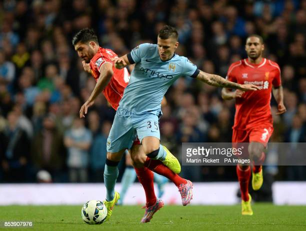 Manchester City's Stevan Jovetic Liverpool's Emre Can battle for the ball and during the Barclays Premier League match at the Etihad Stadium...