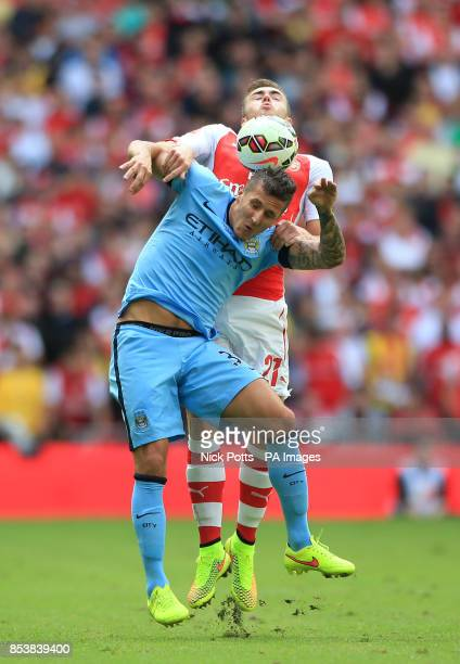 Manchester City's Steven Jovetic and Arsenal's Calum Chambers battle for the ball during the Community Shield match at Wembley Stadium London
