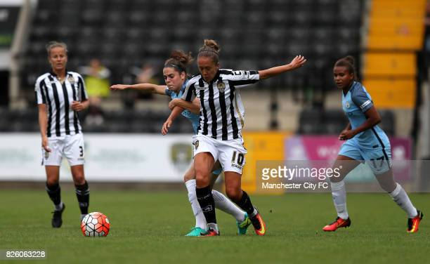 Manchester City's Tessel Middag and Notts County's Jo Potter battle for the ball