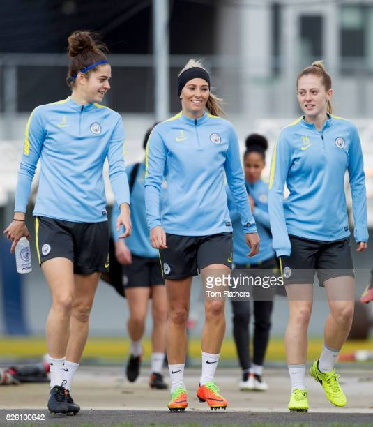 Manchester City's Tessel Middag Toni Duggan amd Keira Walsh walk out for training
