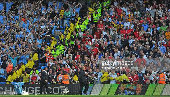 Manchester City's Togolese forward Emmanuel Adebayor celebrates infront of the Arsenal fans after scoring during the English Premier League football...