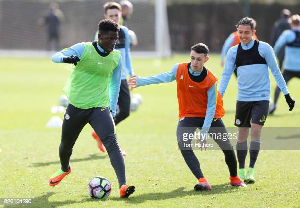 Manchester City's Tom DeleBashiru and Phil Foden in training