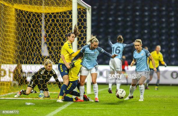 Manchester City's Toni Duggan and Izzy Christiansen in action against Brondby IF