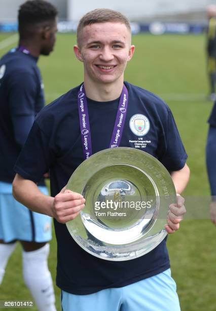 Manchester City's Tyreke Wilson celebrates winning the U18 Northern Premier League trophy