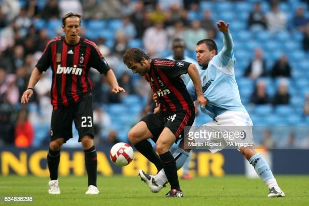 Manchester City's Valeri Bojinov and AC Milan's Mathieu Flamini battle for the ball