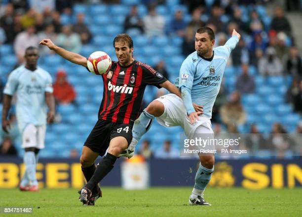 Manchester City's Valeri Bojinov battles with AC Milan's Mathieu Flamini during the friendly match at the City of Manchester Stadium Manchester