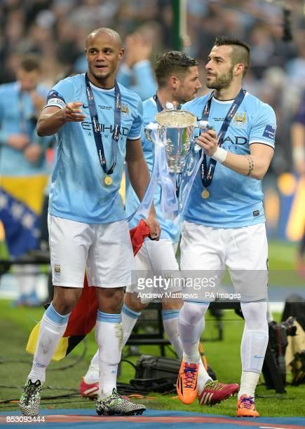 Manchester City's Vincent Kompany and Alvaro Negredo celebrate victory