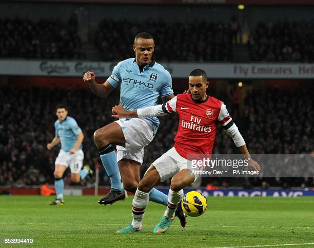 Manchester City's Vincent Kompany and Arsenal's Theo Walcott battle for the ball