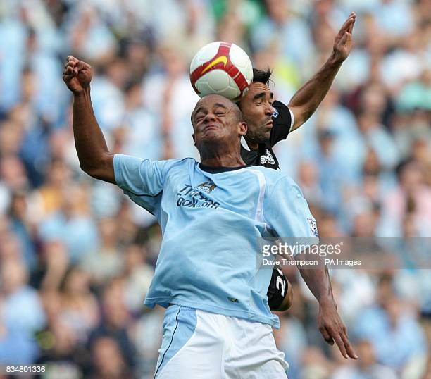Manchester City's Vincent Kompany and Chelsea's Deco battle for the ball