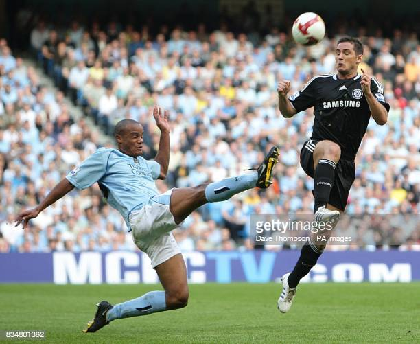 Manchester City's Vincent Kompany and Chelsea's Frank Lampard battle for the ball