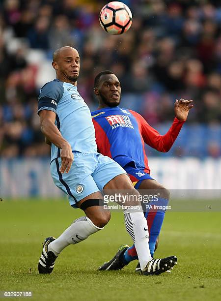 Manchester City's Vincent Kompany and Crystal Palace's Christian Benteke battle for the ball during the Emirates FA Cup fourth round match at...