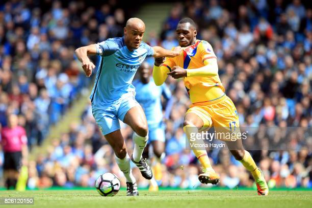 Manchester City's Vincent Kompany and Crystal Palace's Christian Benteke battle for the ball